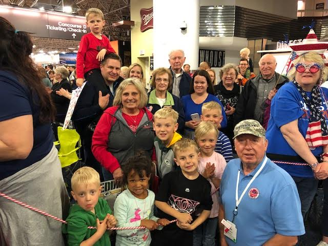 VFW Post 9202 Member John Schaetzel returns home from The Honor Flight shown with part of his family at MKE Airport May 11, 2019. It was an Honor to be on The Honor Flight with many Veteran friends not only from the Vietnam War but also WWII and Korean War as well.  To be sponsored by my son-Jesse and his family, spending the day with him on this trip to Washington DC was a memorable, emotional day.